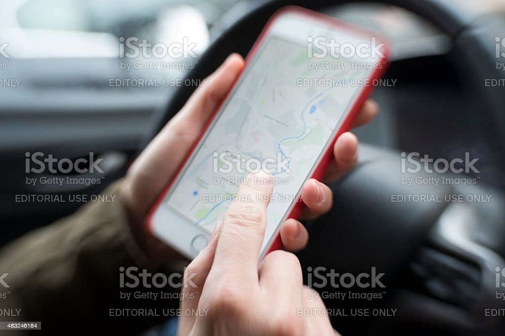 Smartphone mapping while driving stock photo