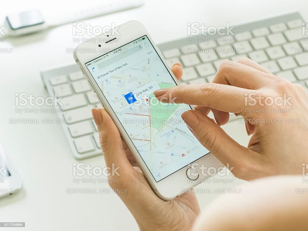 Smartphone Mapping While in Office stock photo