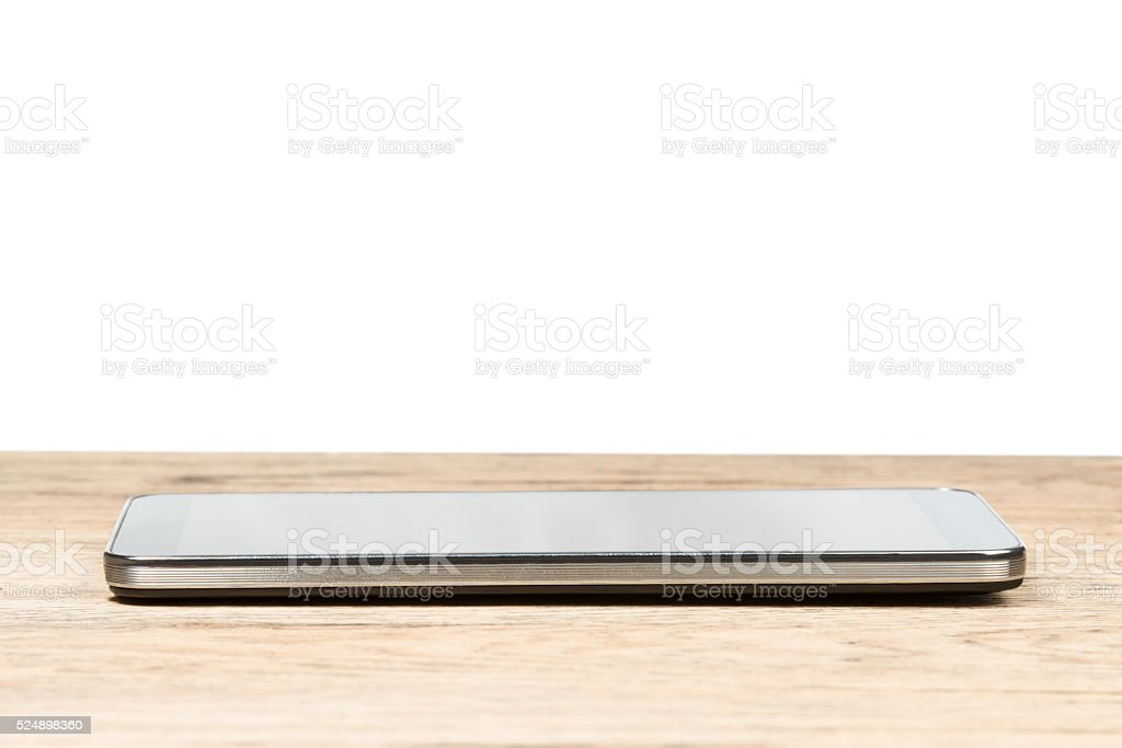 Smartphone on a wooden table stock photo