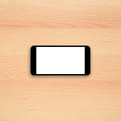 Smartphone on office desk. Horizontal view