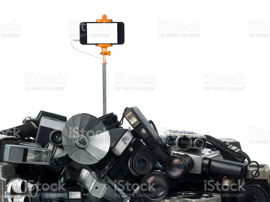 Smartphone On Selfie Stick On Top Of Antique Cameras stock photo