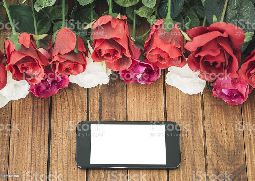 Smartphone on St. Valentine decoration background royalty-free stock photo