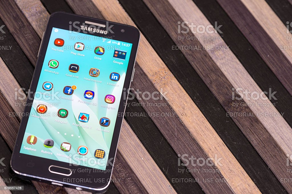 Smartphone on striped wood table with copy space stock photo