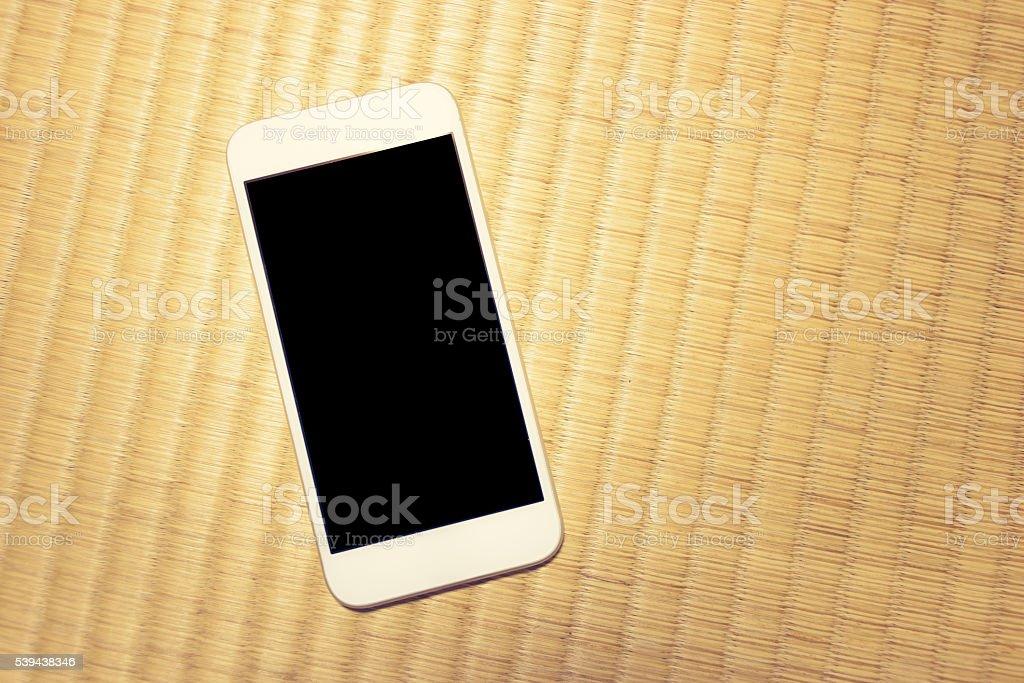 Smartphone on Tatami Floor stock photo