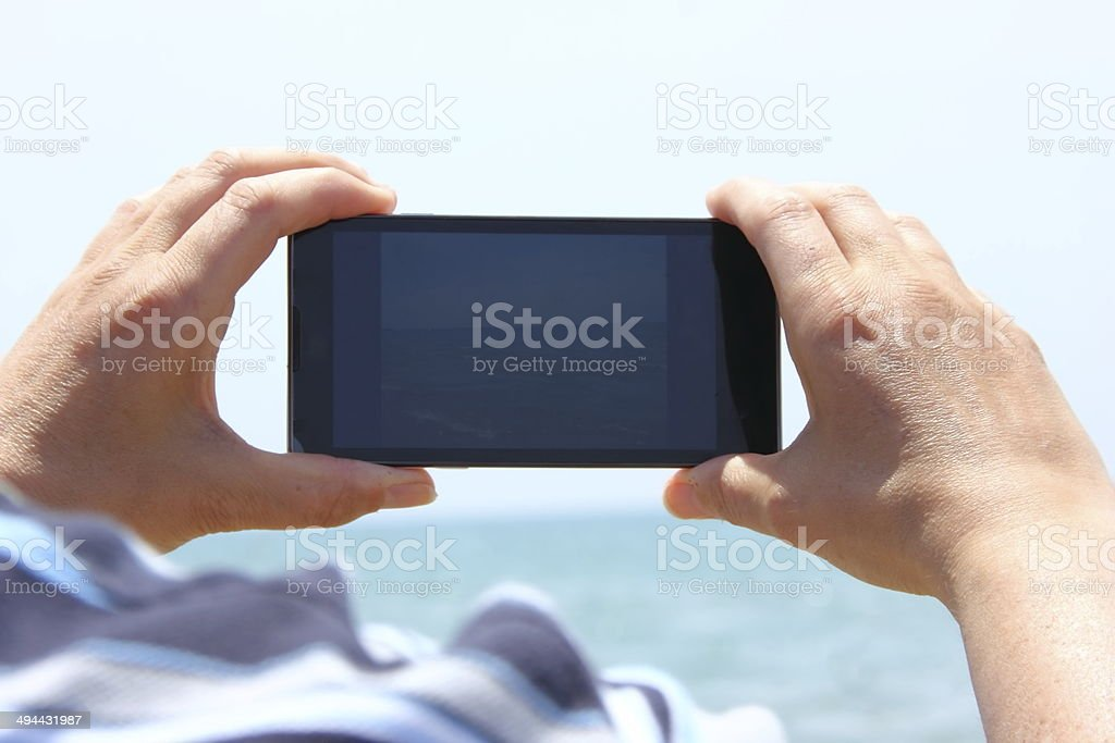 smartphone on the beach royalty-free stock photo