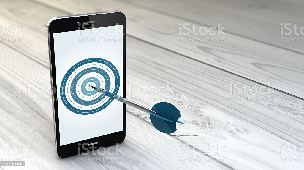 smartphone over white wooden background with target stock photo