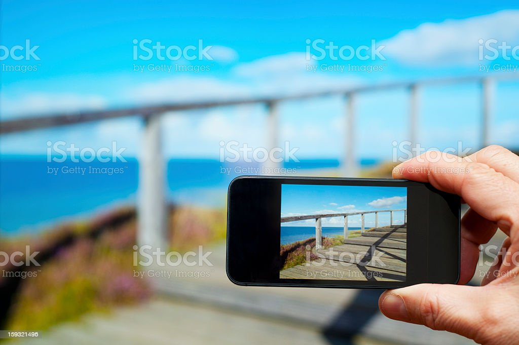 Smartphone screen synchronized to TV, viewing pictures royalty-free stock photo