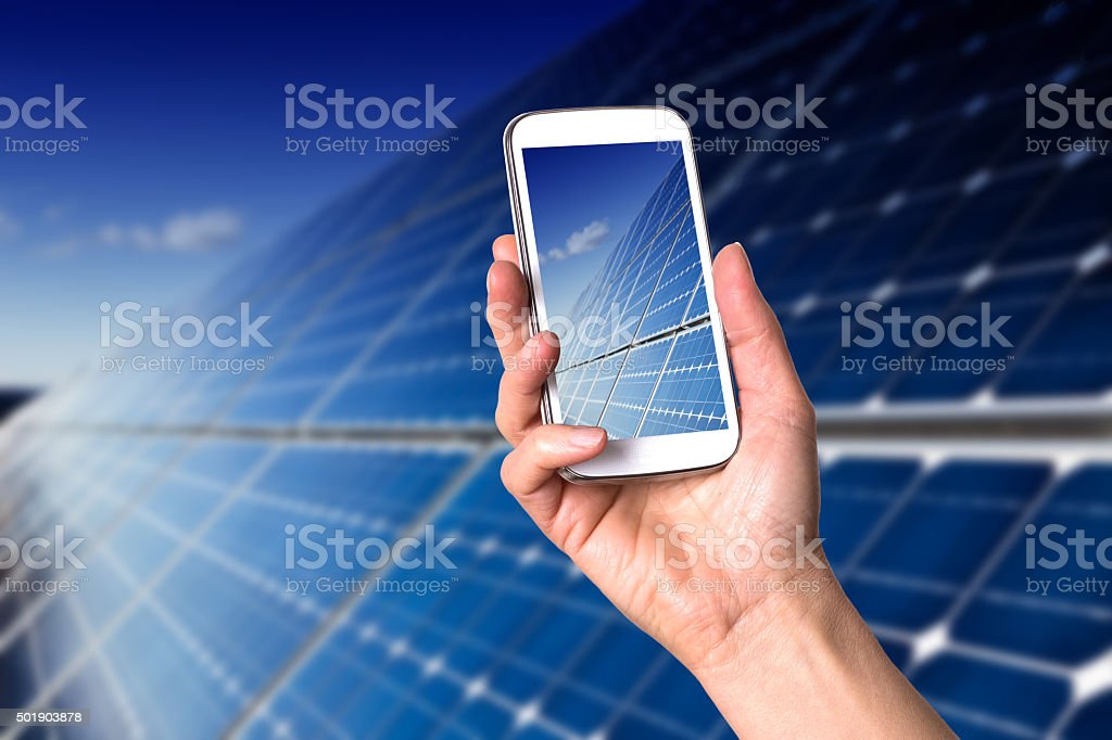 Smartphone showing blue solar panels stock photo