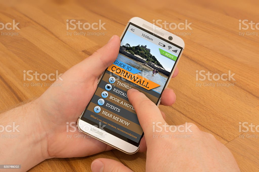 Smartphone swiping / gesture control Cornwall Travel Guide stock photo