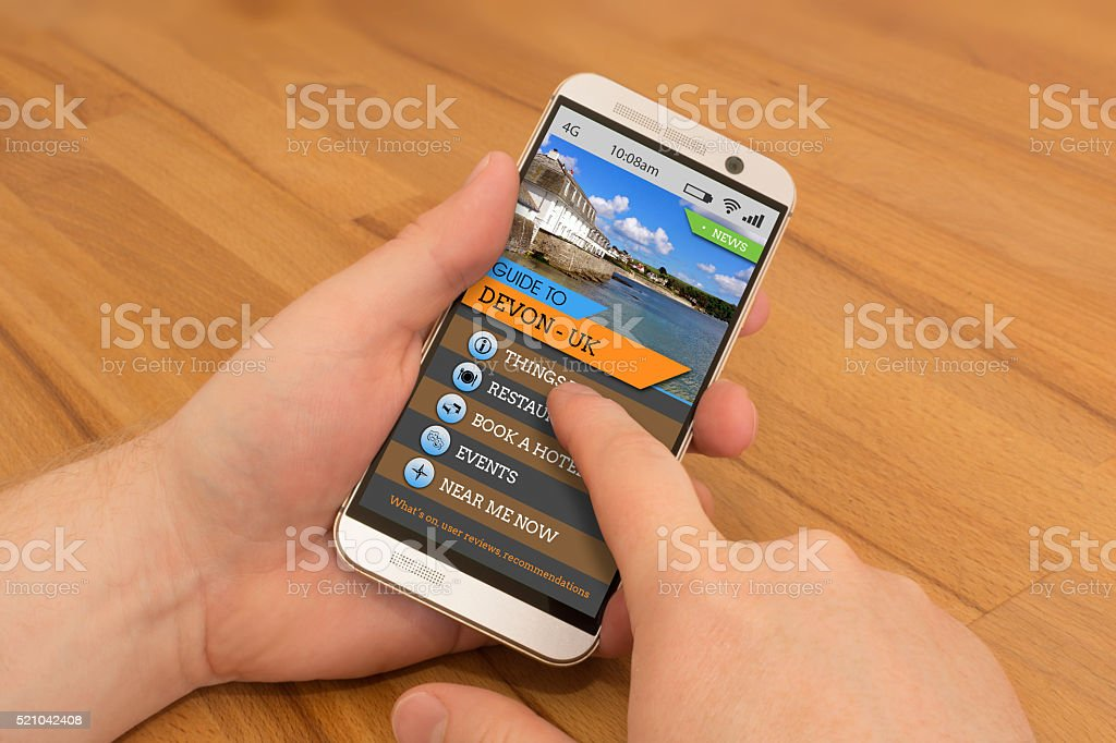 Smartphone swiping / gesture control Devon Travel Guide stock photo