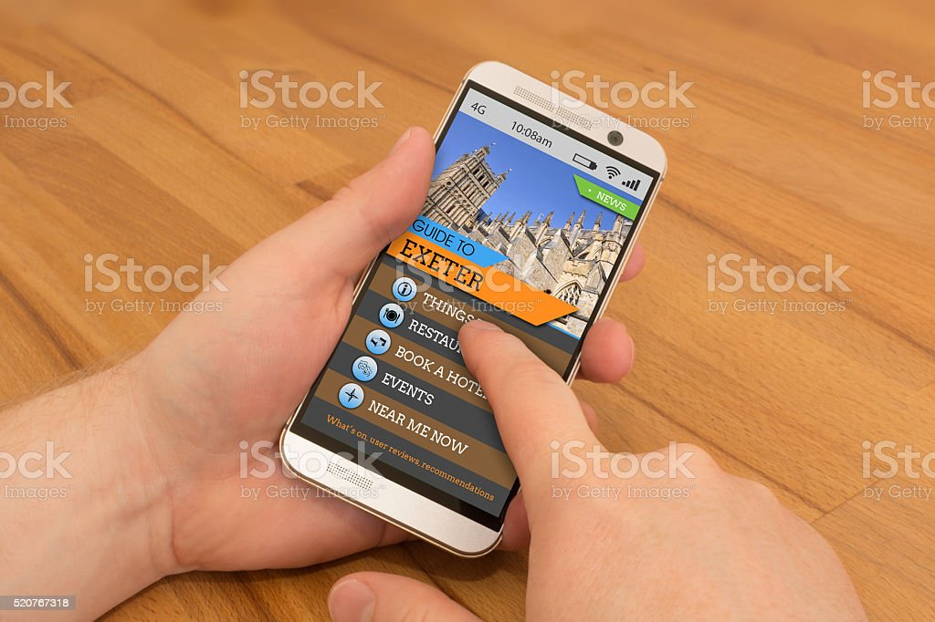 Smartphone swiping / gesture control Exeter Travel Guide stock photo