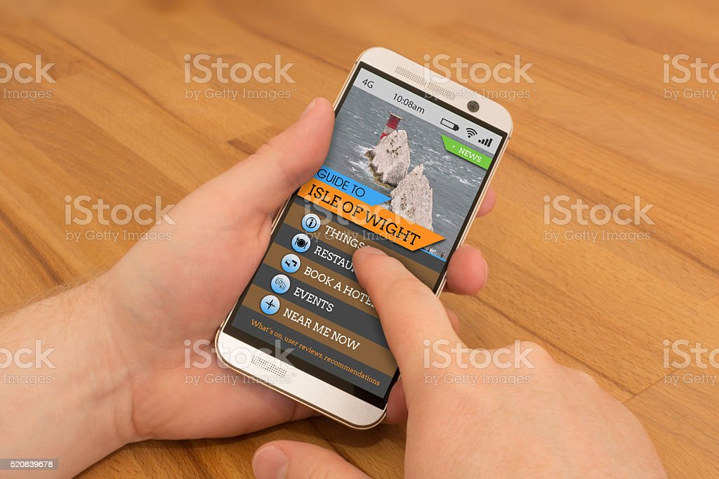 Smartphone swiping / gesture control Isle of Wight Travel Guide stock photo