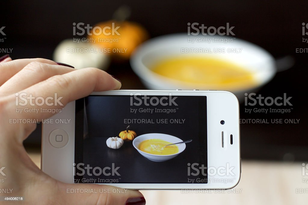 smartphone taking food styling photo of a soup stock photo
