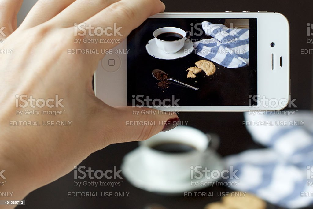 smartphone taking photo of a coffee cup stock photo