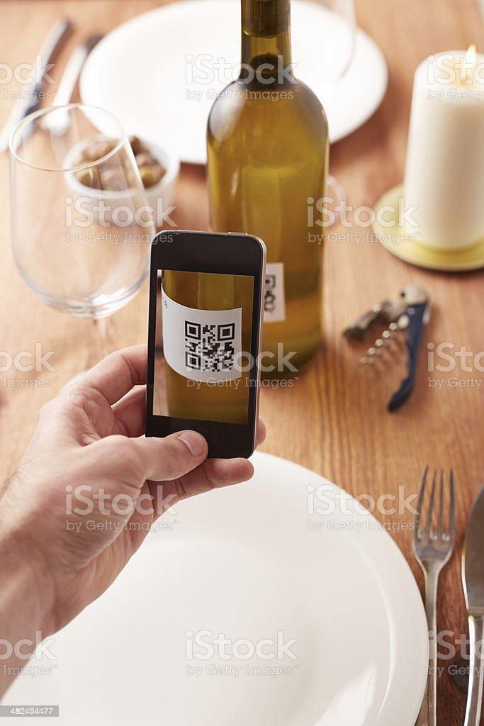 Smartphone taking photo of QR code stock photo