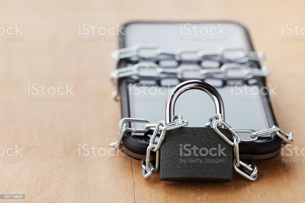 Smartphone tied chain with lock, digital devices detox concept stock photo