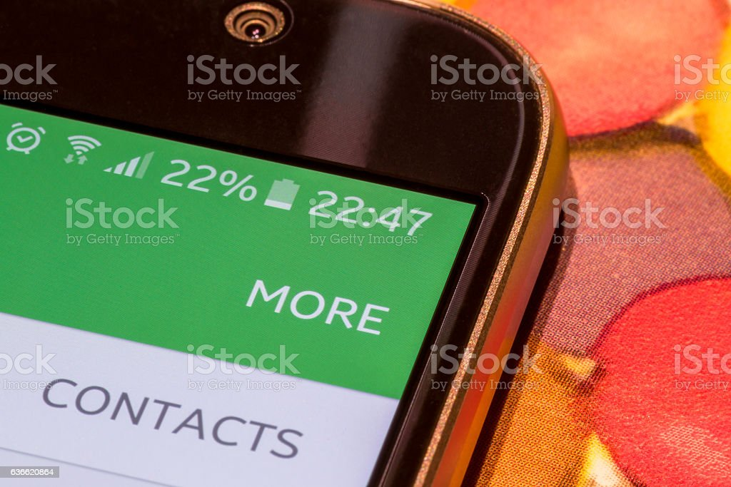 Smartphone with 22 percent battery charge on the screen stock photo