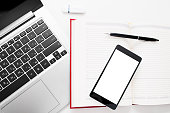 Smartphone with blank screen on office stuff