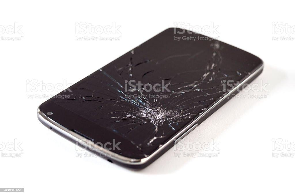 Smartphone with broken glass screen stock photo