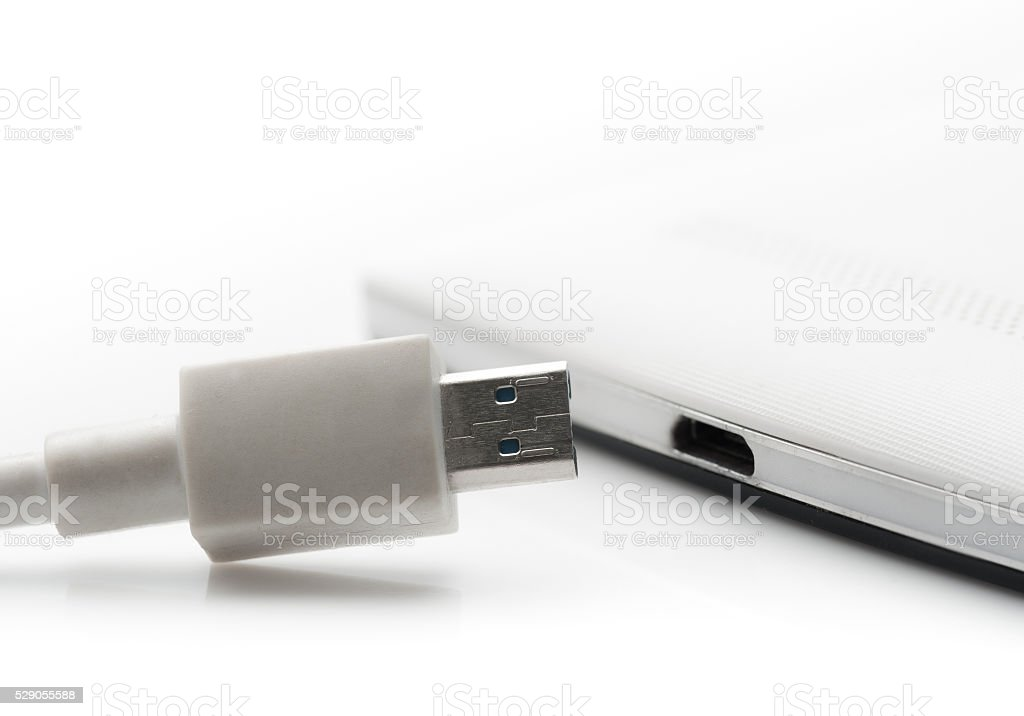 Smartphone with charger on white background,USB cable stock photo