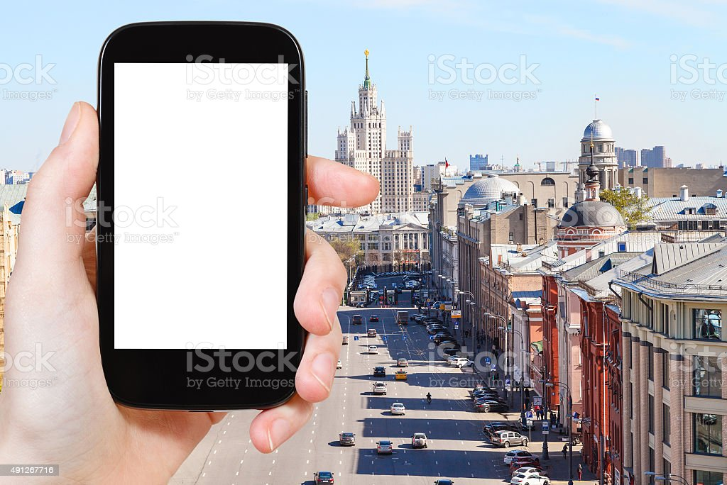 smartphone with cut out screen and Moscow street stock photo
