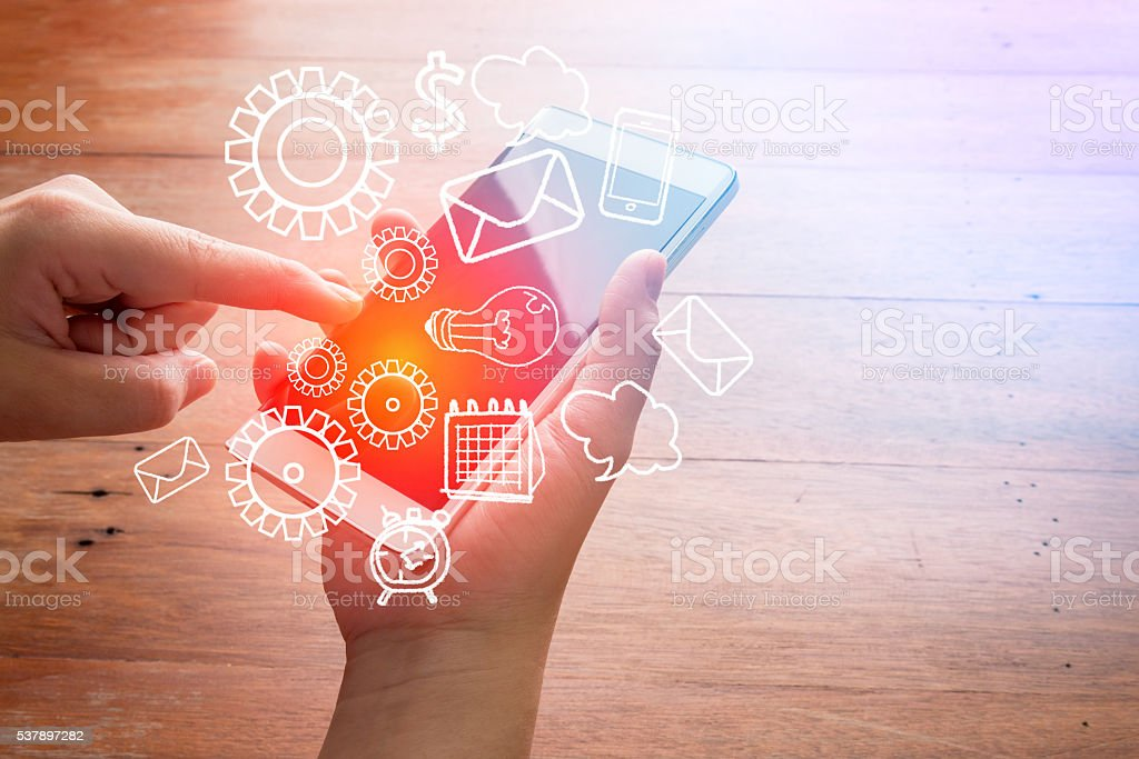 Smartphone with finance and market icons stock photo