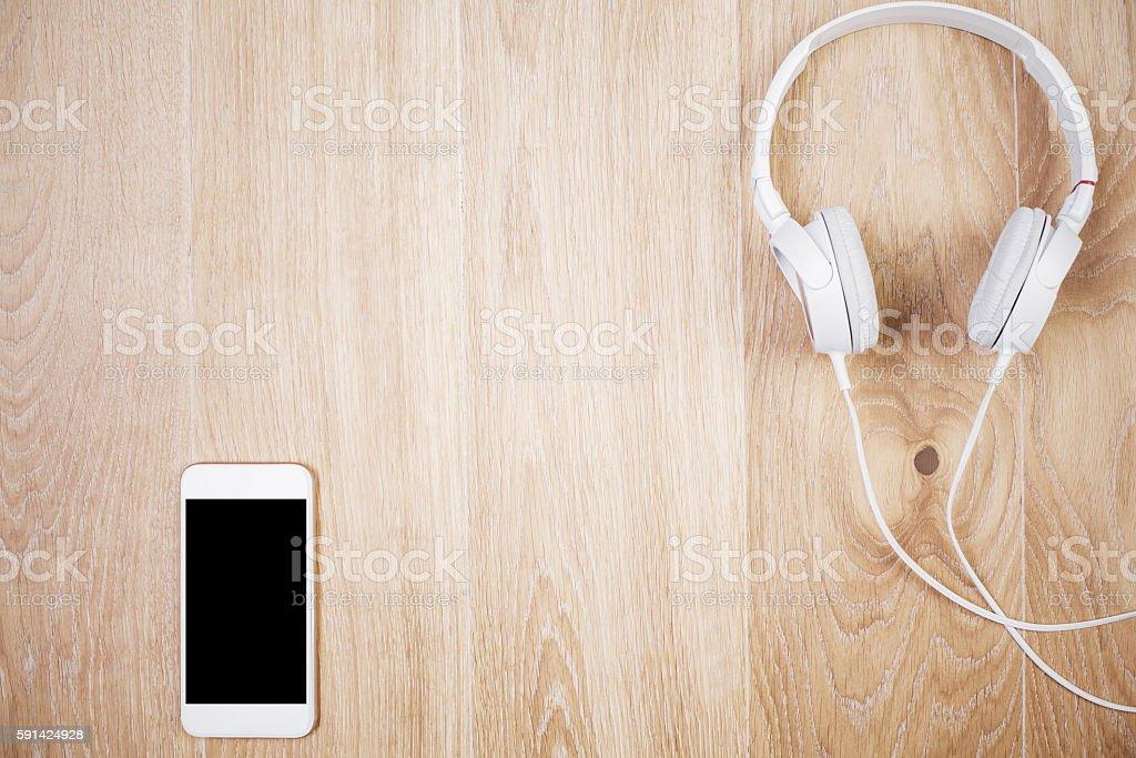 Smartphone with headphones stock photo