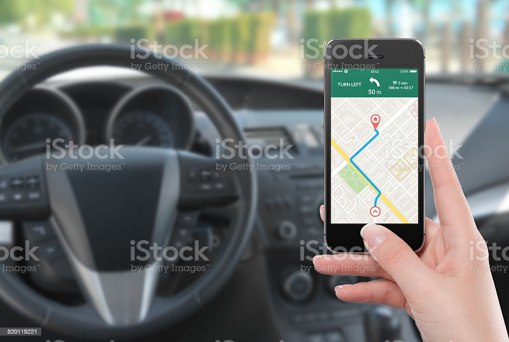 Smartphone with map gps navigation app on the screen stock photo