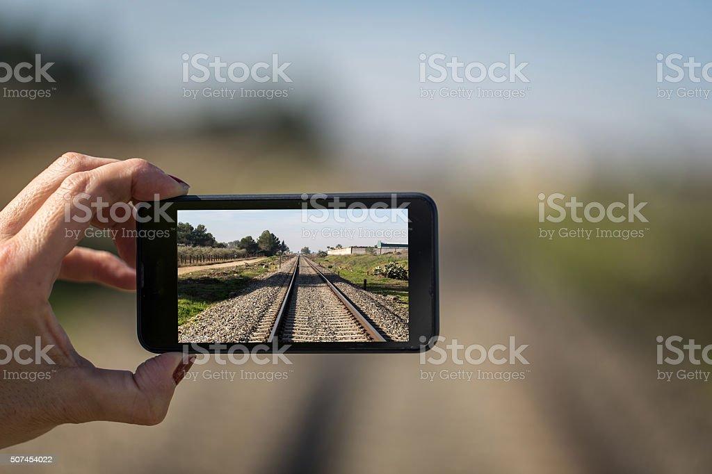 Smartphone with photo of railway stock photo