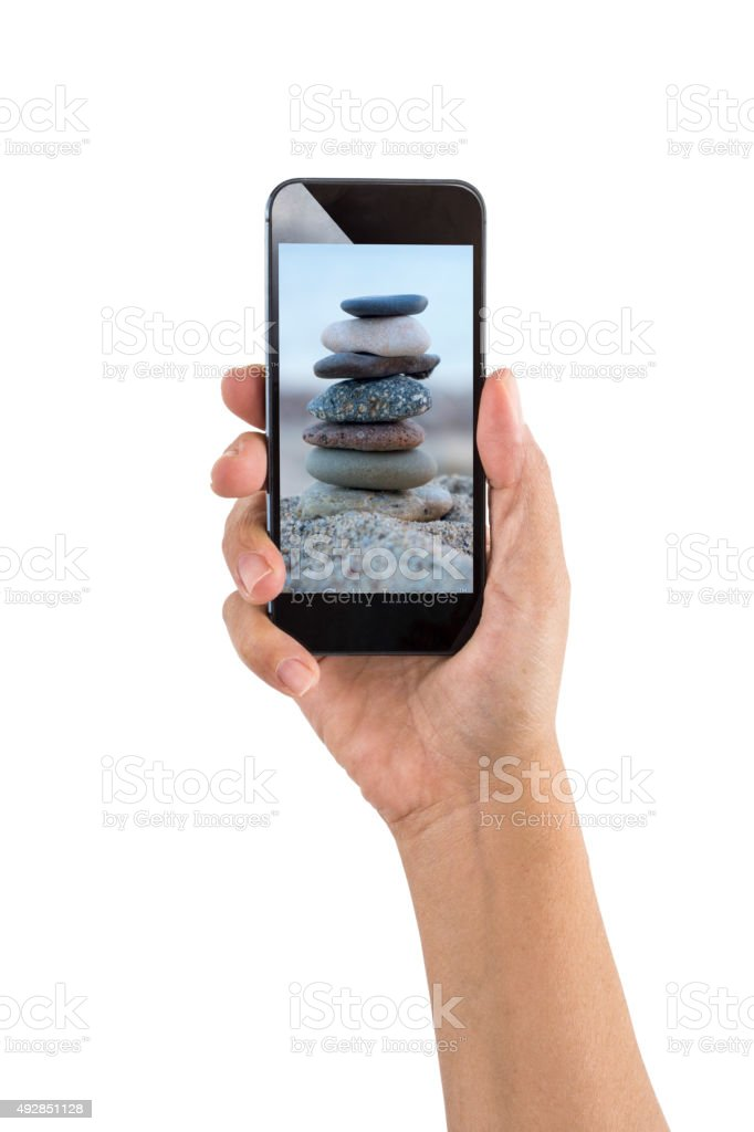 Smartphone with Stacked Stones for Zen stock photo