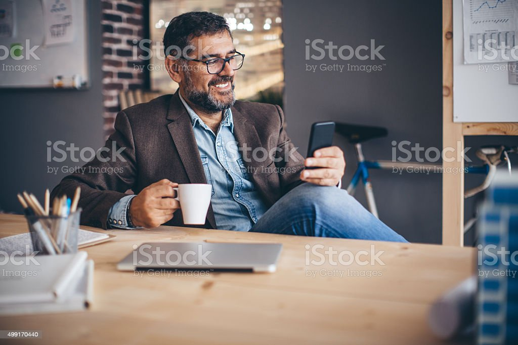 Smartphones make busy easy stock photo