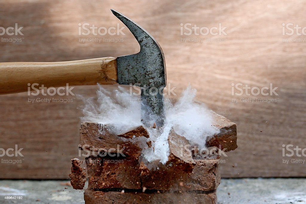 smash brick stock photo