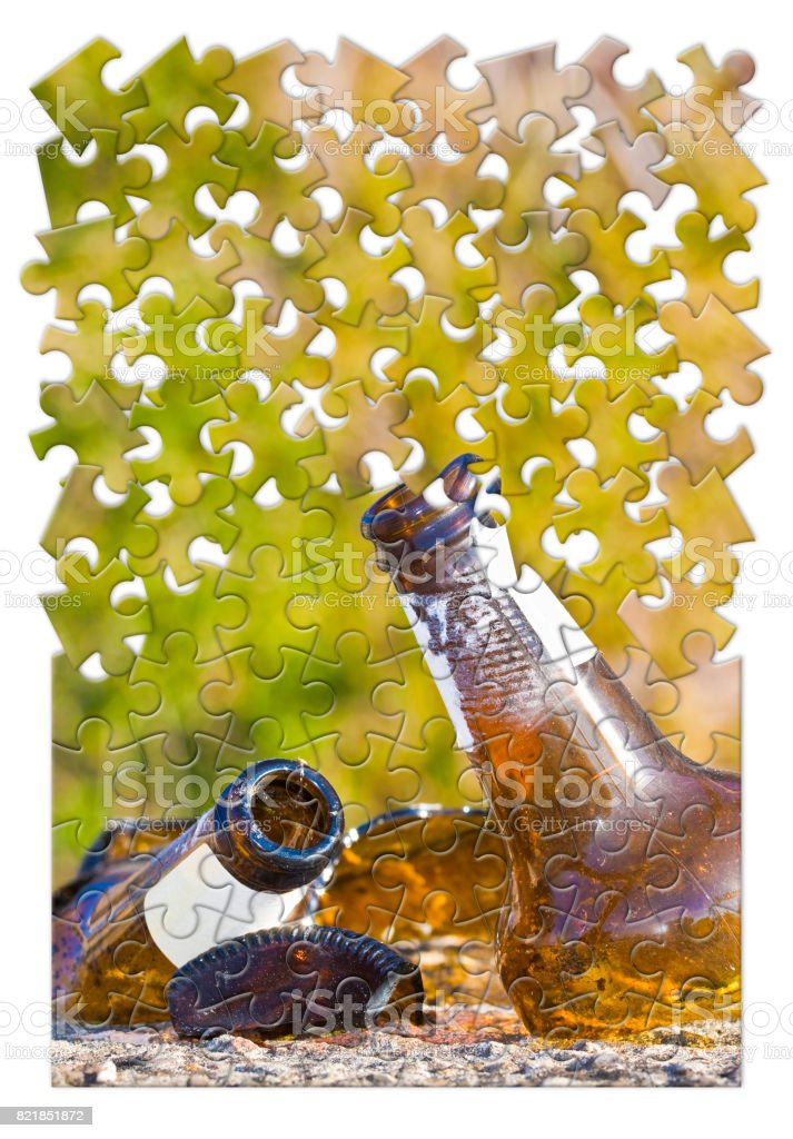 Smashed bottle of beer resting on the ground - Address the alcoholism issue  - Concept image in jigsaw puzzle shape stock photo
