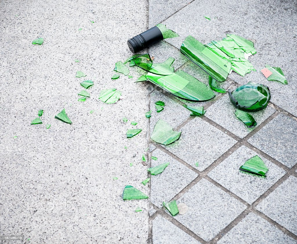 Smashed Glass Bottle on the Street royalty-free stock photo