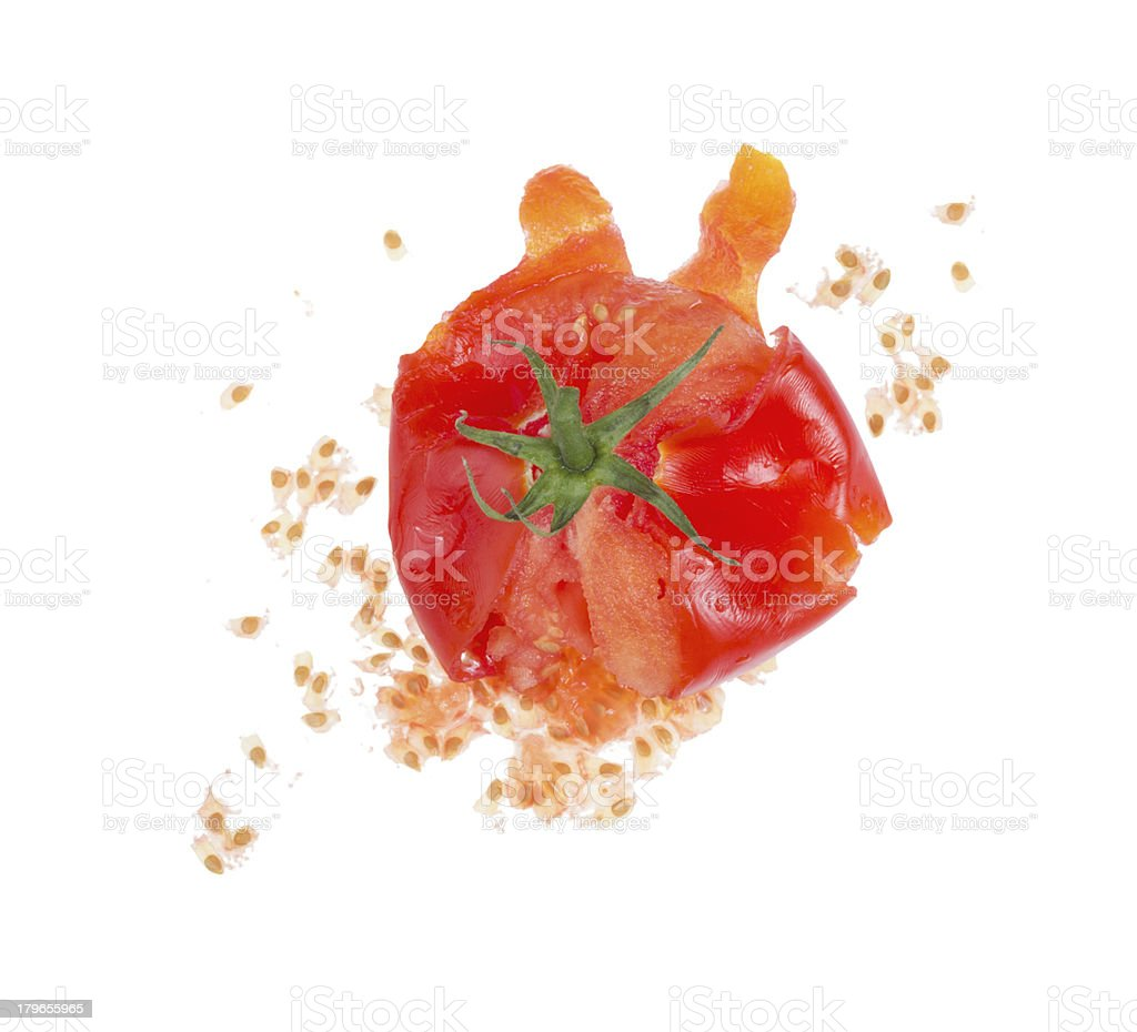 A smashed red tomato on a white background stock photo