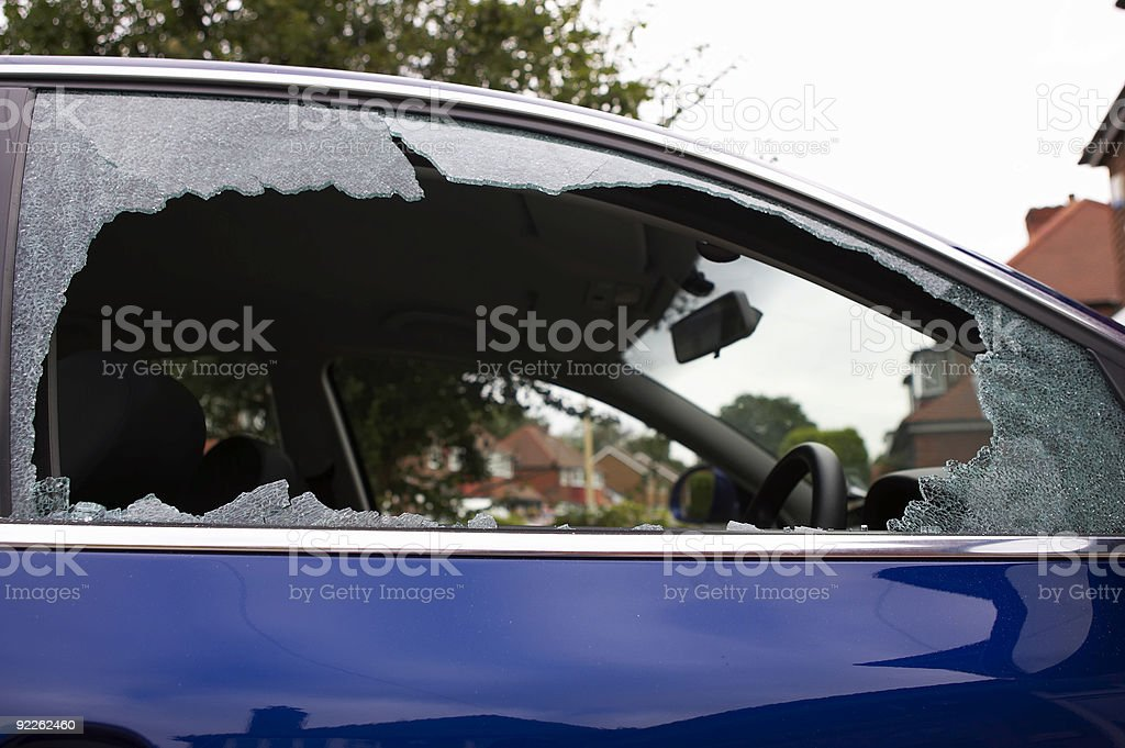 Smashed safety glass in a car door royalty-free stock photo