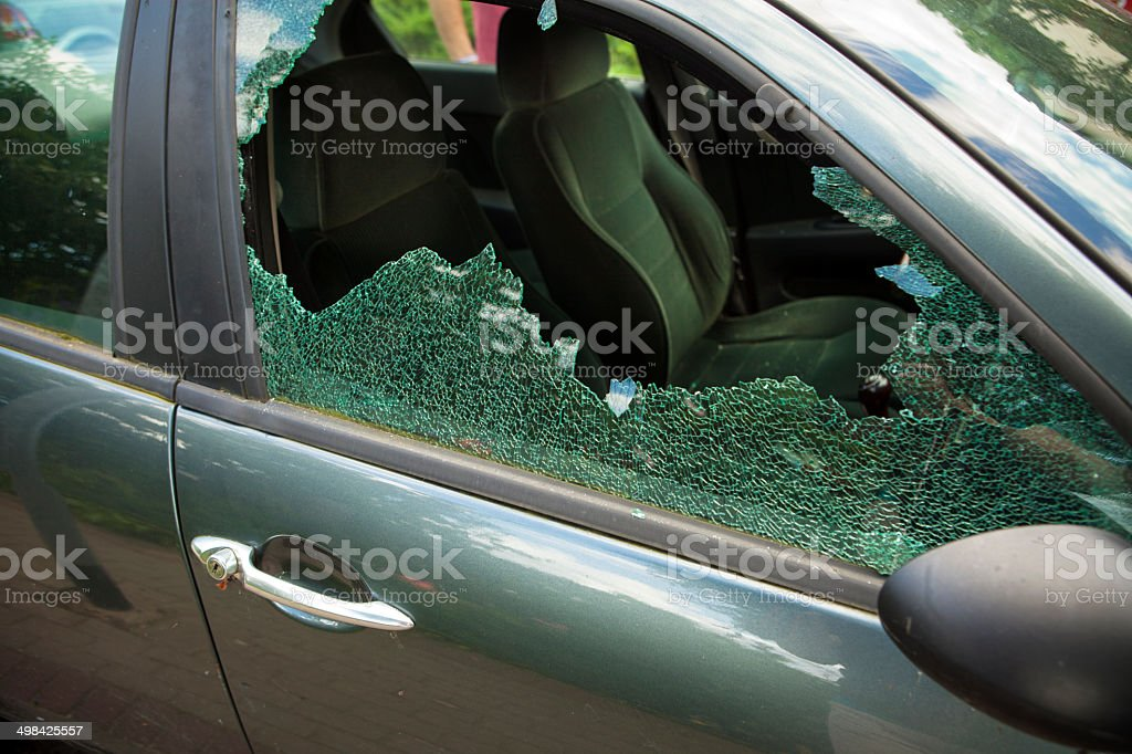 Smashed window in  car stock photo