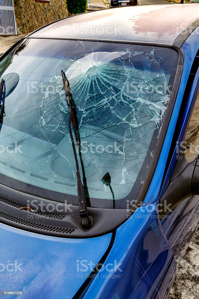 Smashed windshield with head. Driver using no seat belt. stock photo