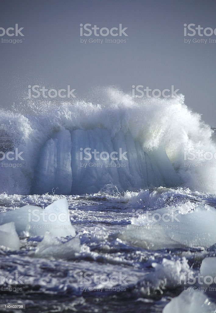 Smashing iceberg stock photo