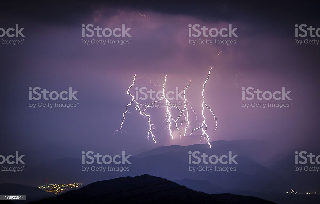 Smashing lightning during a storm over the small city royalty-free stock photo
