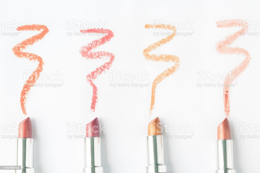 Smears of various lipsticks on white backgrounds stock photo