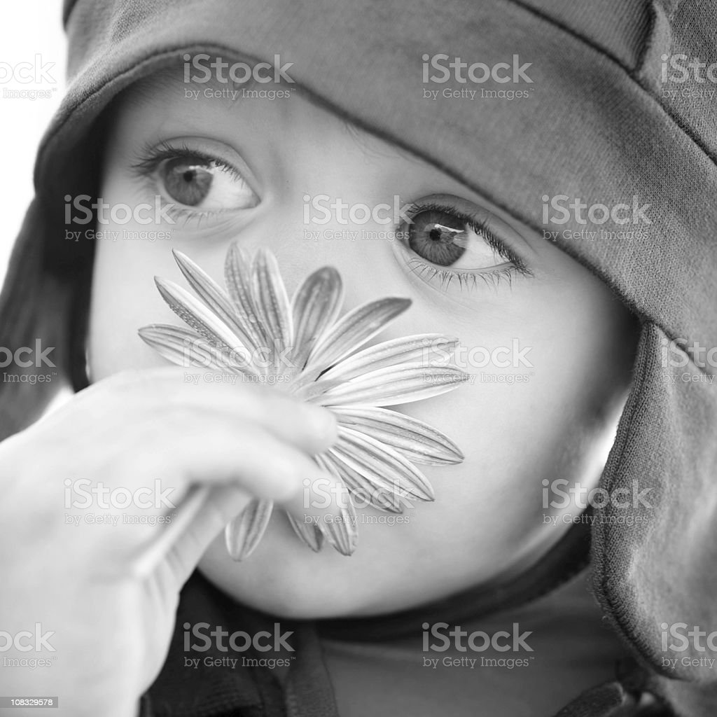 Smelling a flower royalty-free stock photo