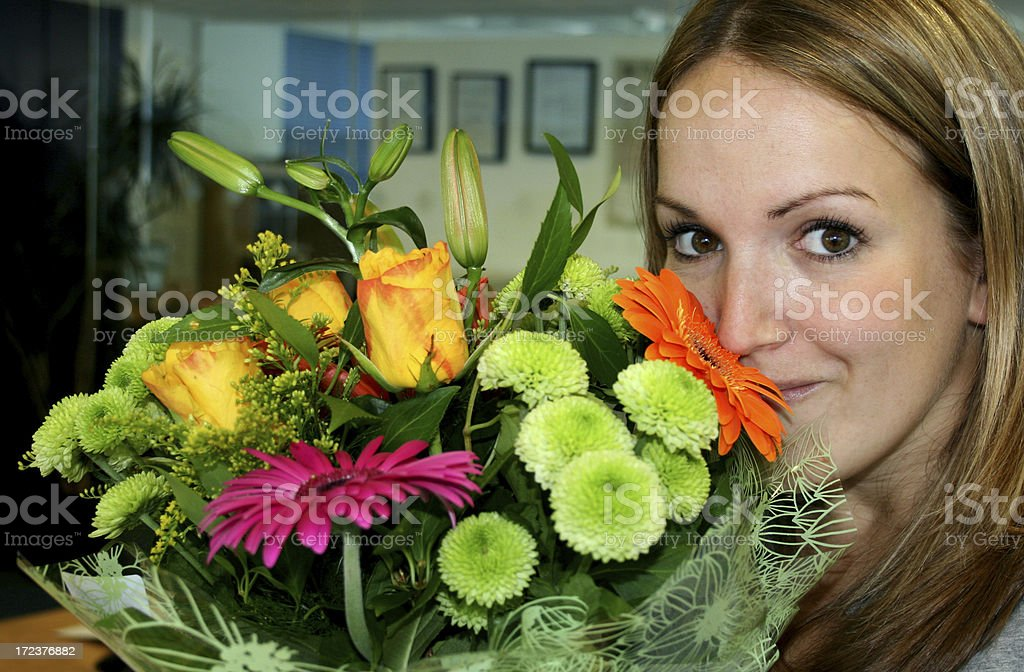 smelling fresh flowers royalty-free stock photo