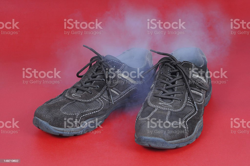 Smelling shoes royalty-free stock photo