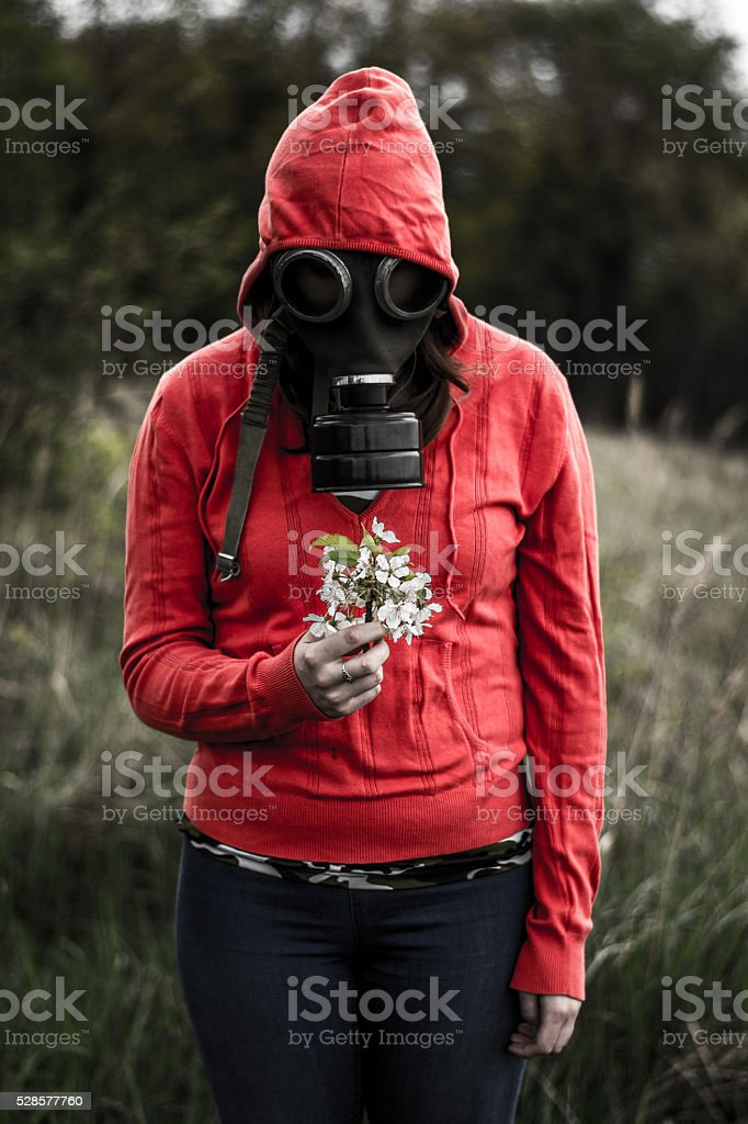 smelling the flower in the Toxic Environment stock photo