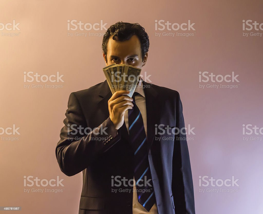 Smelling The Money stock photo