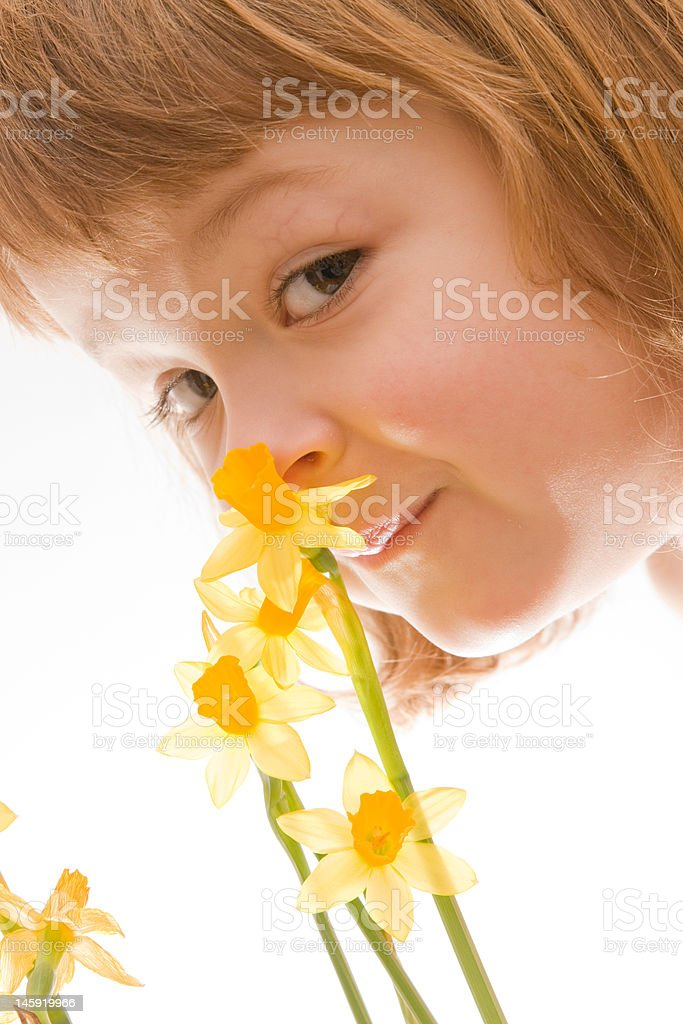 smelling the spring stock photo