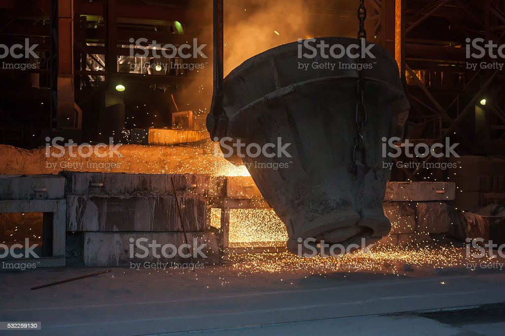 Smelting metal in a metallurgical plant royalty-free stock photo
