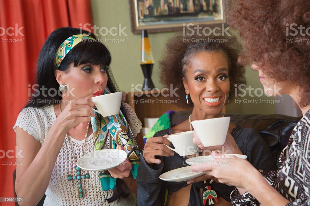 Smiilng Mature Women Having Tea stock photo