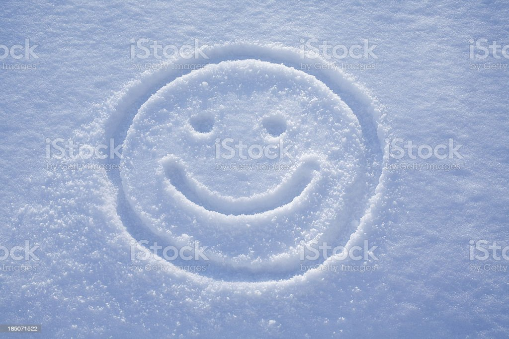 Smile. A face drawing in the snow. stock photo